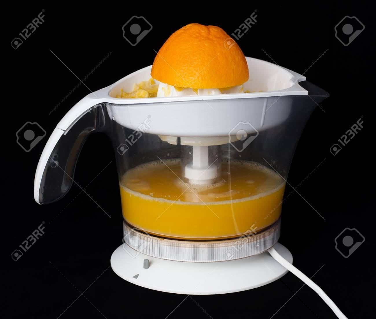 White citrus Juicer and oranges. Black background Stock Photo - 11690258