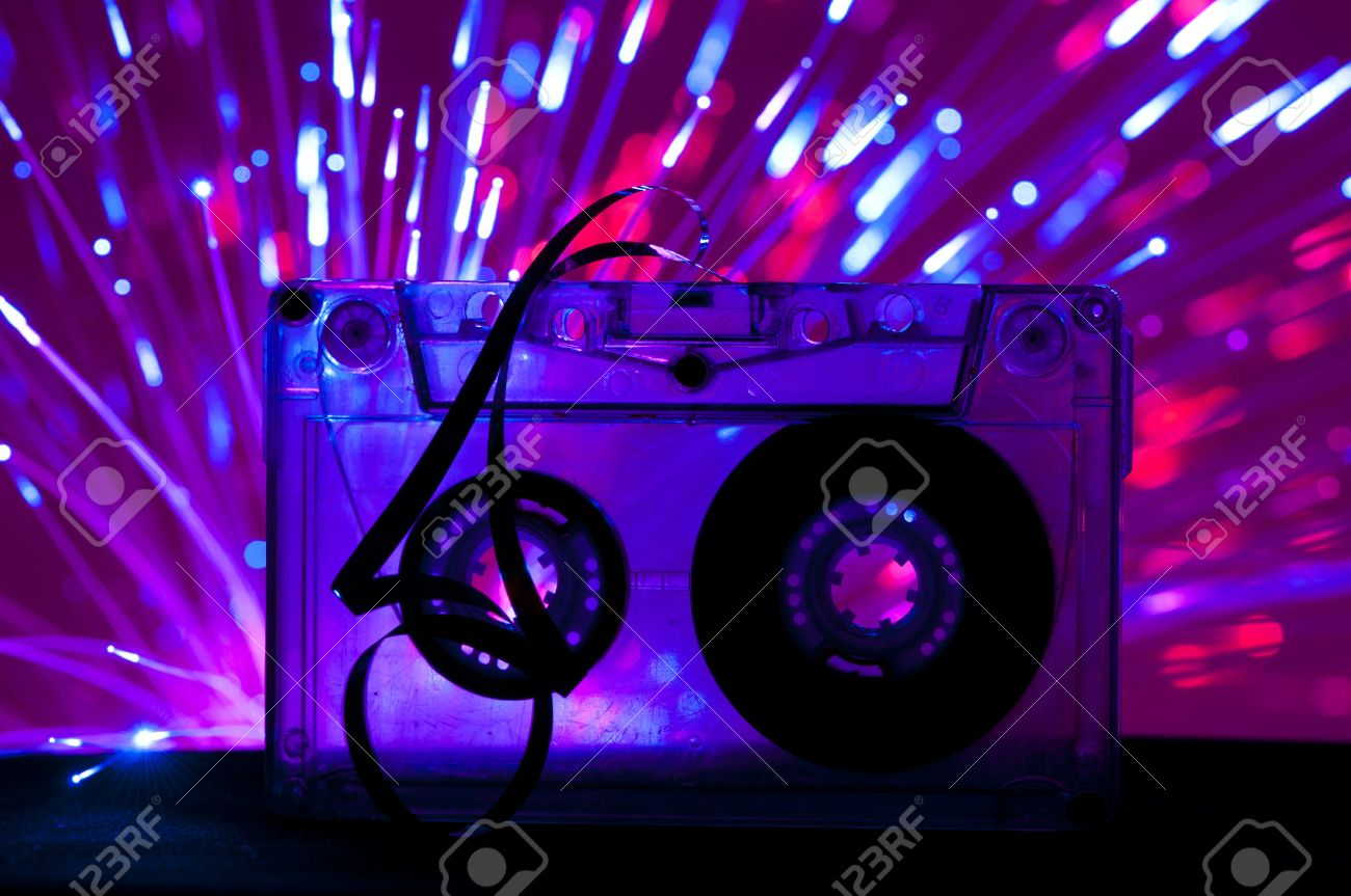 Transparent Cassette Tape And Blue Pink Color Disco Light Background