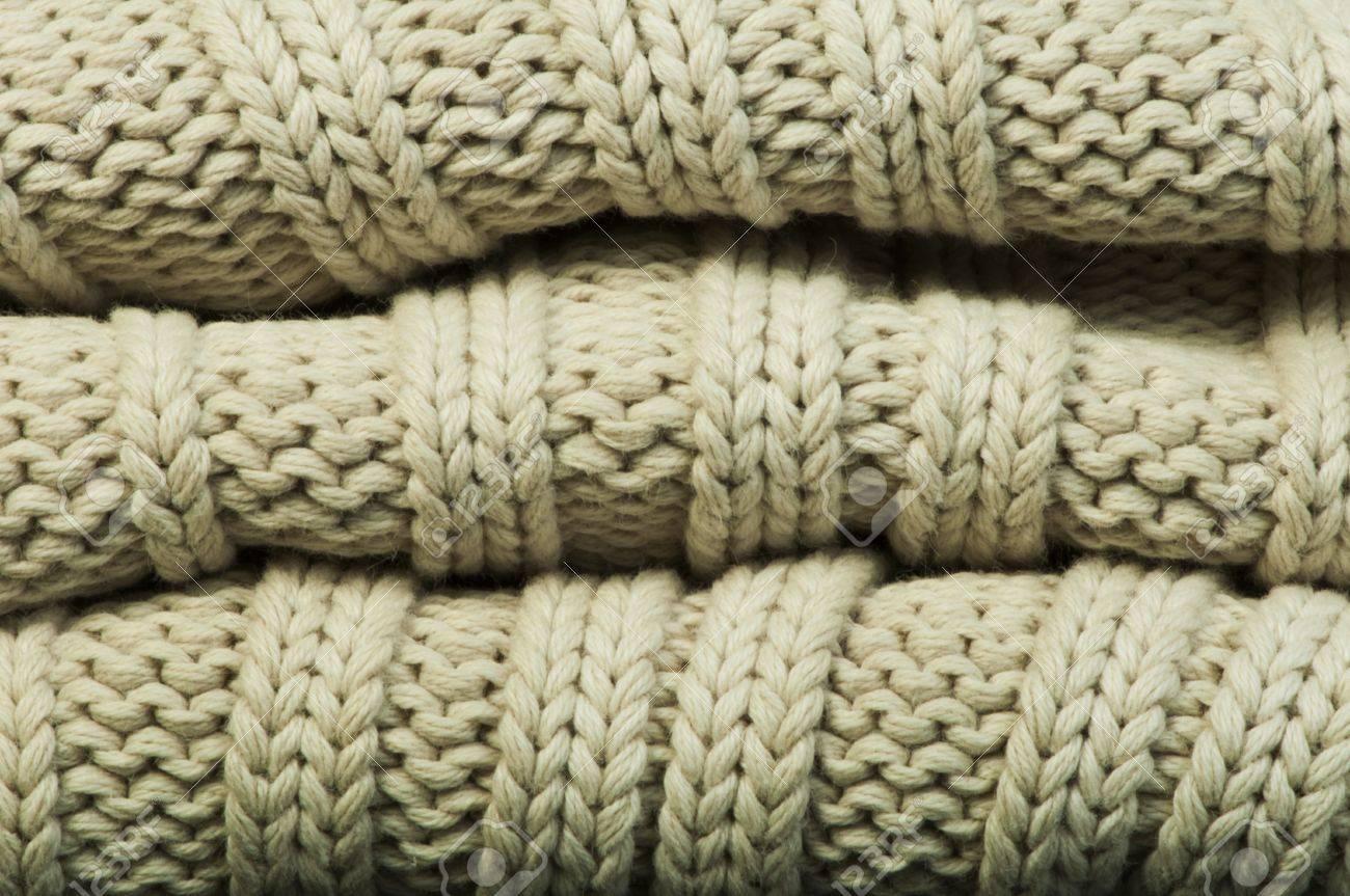 31f28de2af5553 Old knit sweater background. Beige color. Studio shot Stock Photo - 18236464