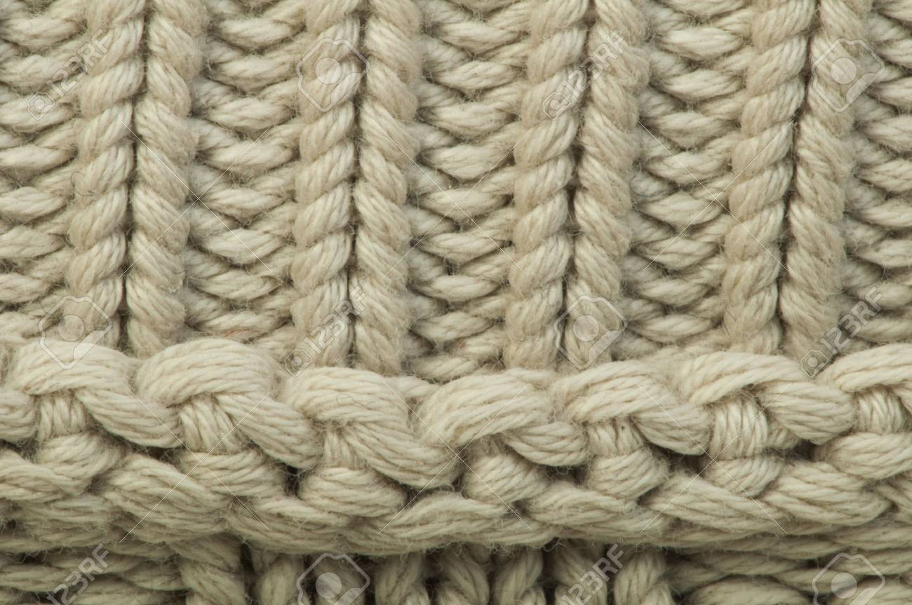 624d4f0cb00f29 Old knit sweater background. Beige color. Studio shot Stock Photo - 18236466