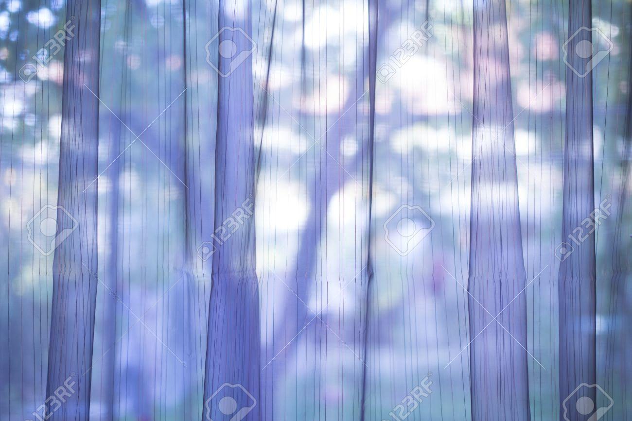 Purple transparent curtain on a window - 23158557
