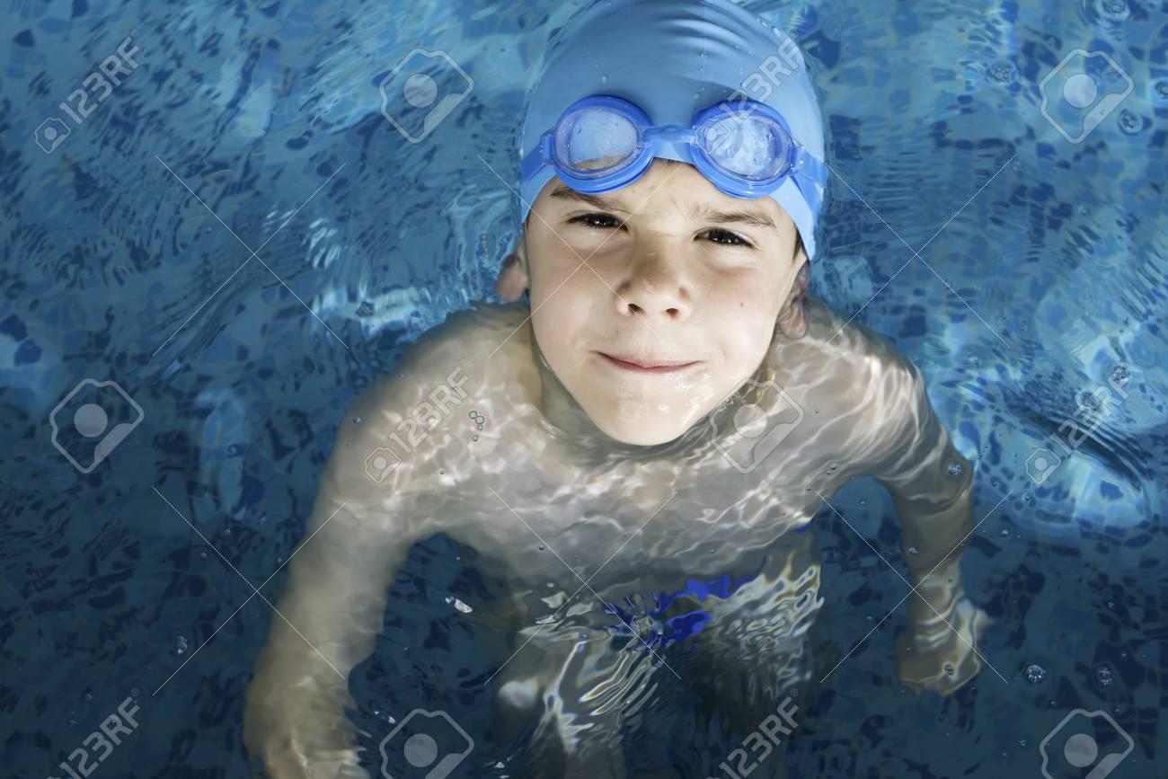 Little boy in swimming pool. Blue swimming pool. Stock Photo - 28634678