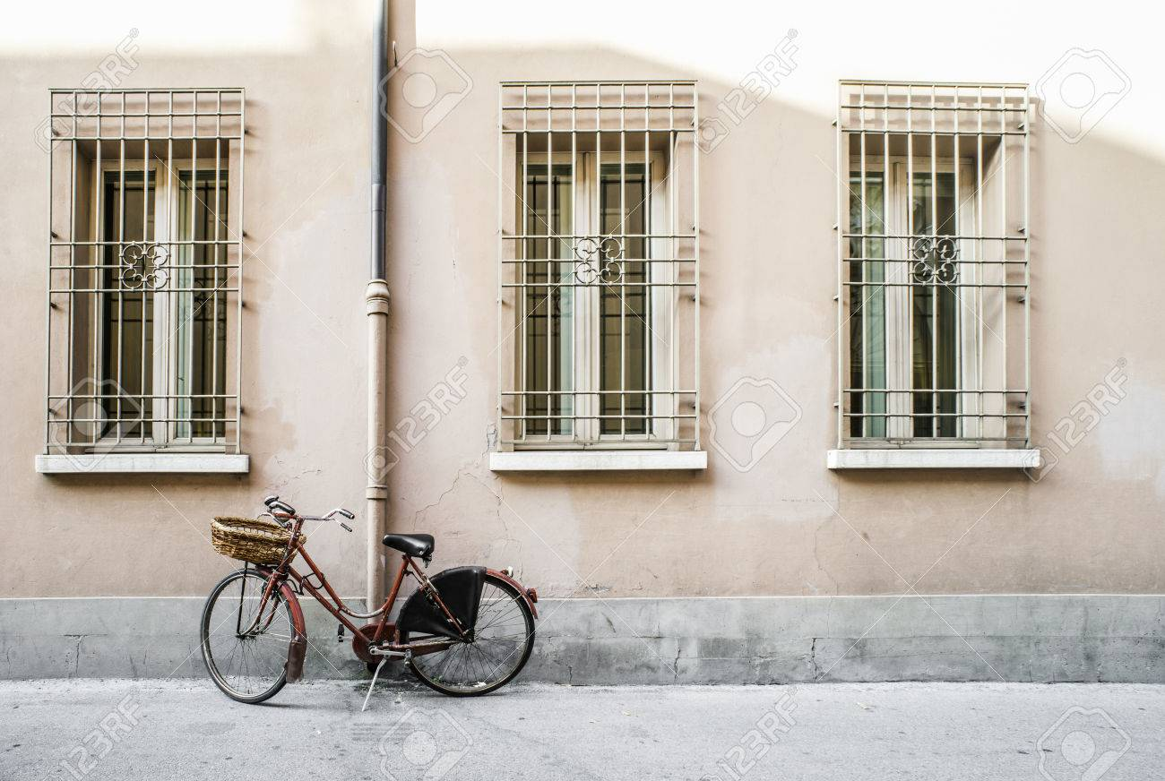 Red old Italian bicycle on sunlight. Ancient buildings - 30262166