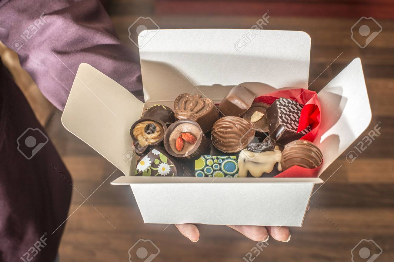 Hands holding a box of chocolates. Close up - 40111477
