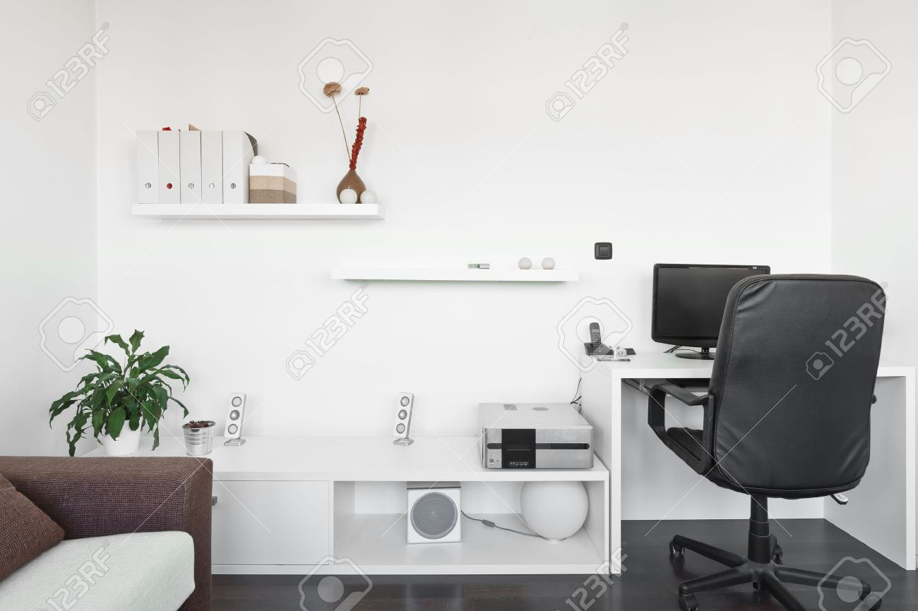 Modern Living Room With Computer Desk And The Screen, Sofa And Table With  White Carpet