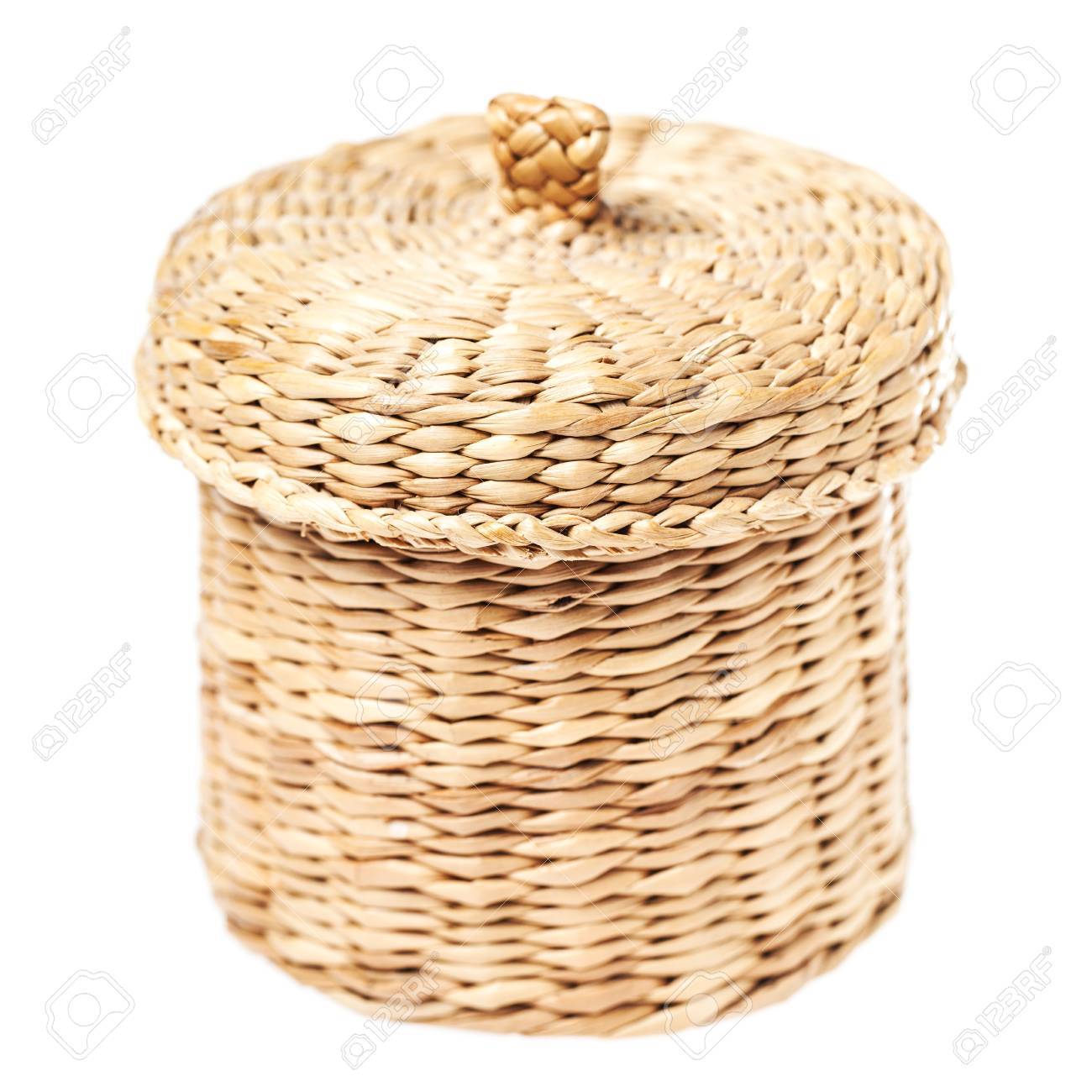 Light brown wicker basket with closed lid, isolated on white background Stock Photo - 21973893