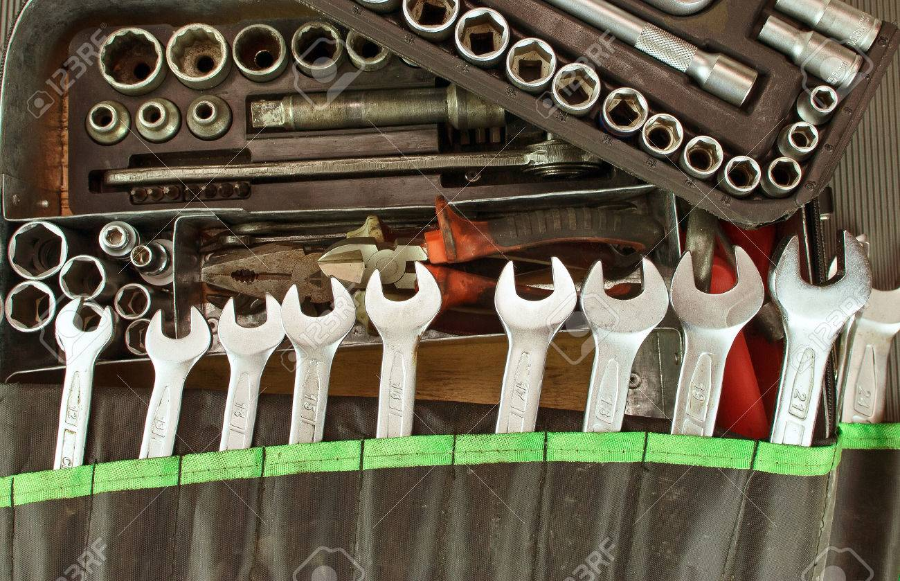 Many dirty set of hand tools on a vintage background - 55190712