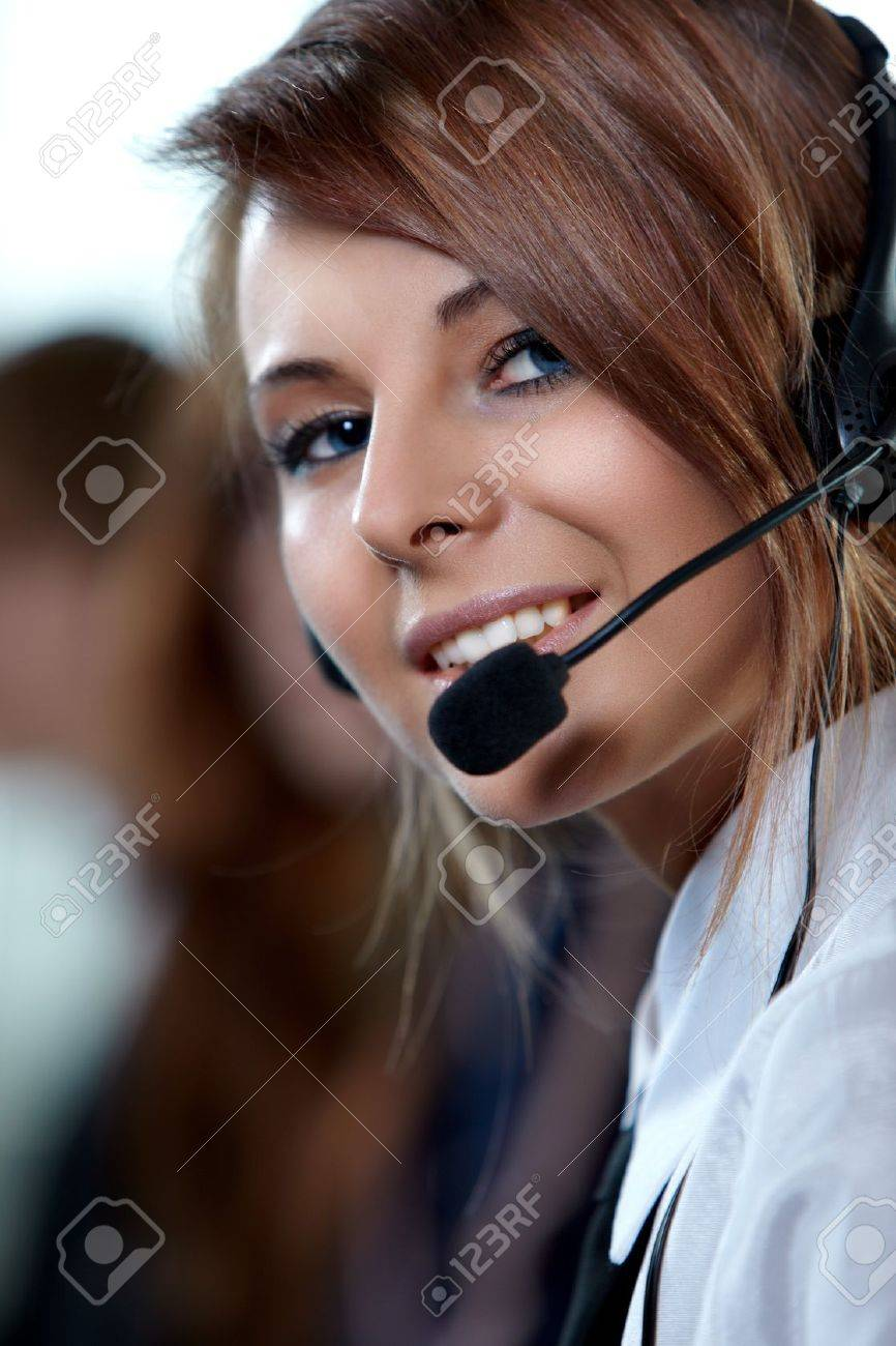Beautiful representative smiling call center woman with headset. Stock Photo - 7651273