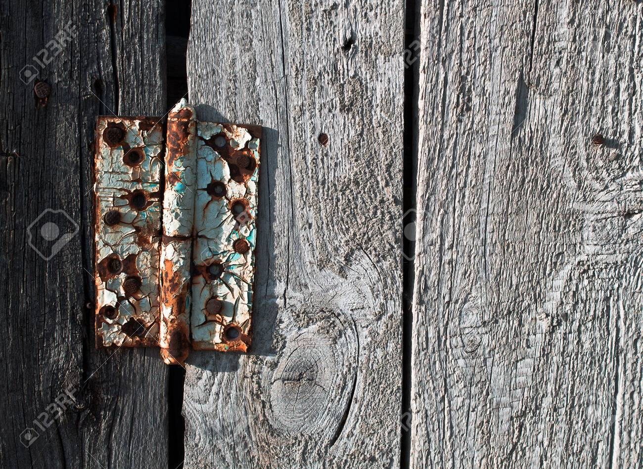 Rusty Door old rusty metal door hinge on wooden door stock photo, picture and