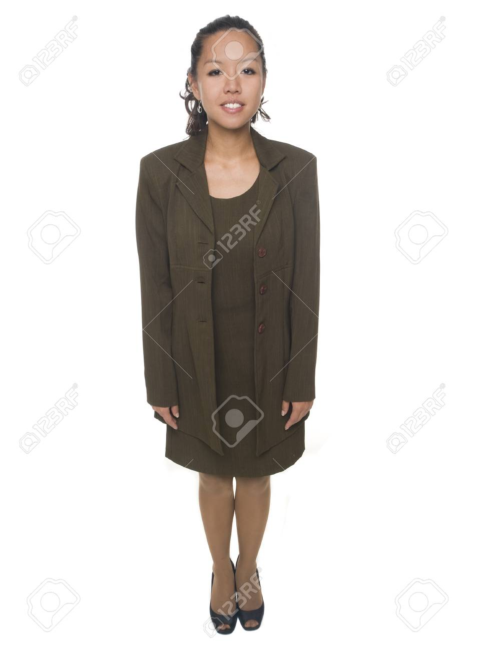 Isolated full length studio shot of a businesswoman looking at the camera and smiling. Stock Photo - 8081158