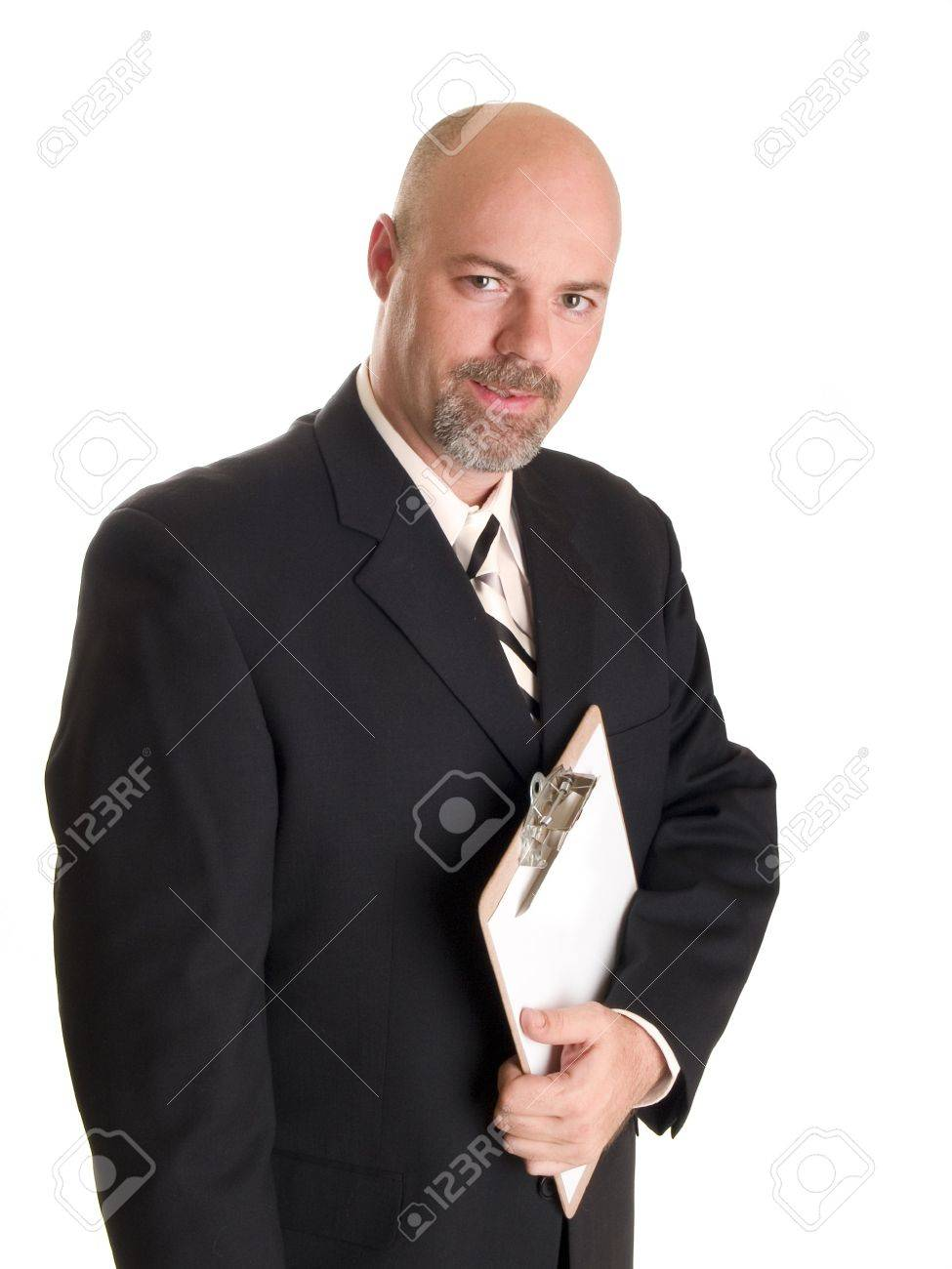 Stock photo of a well dressed businessman holding a clipboard, isolated on white. Stock Photo - 8081029