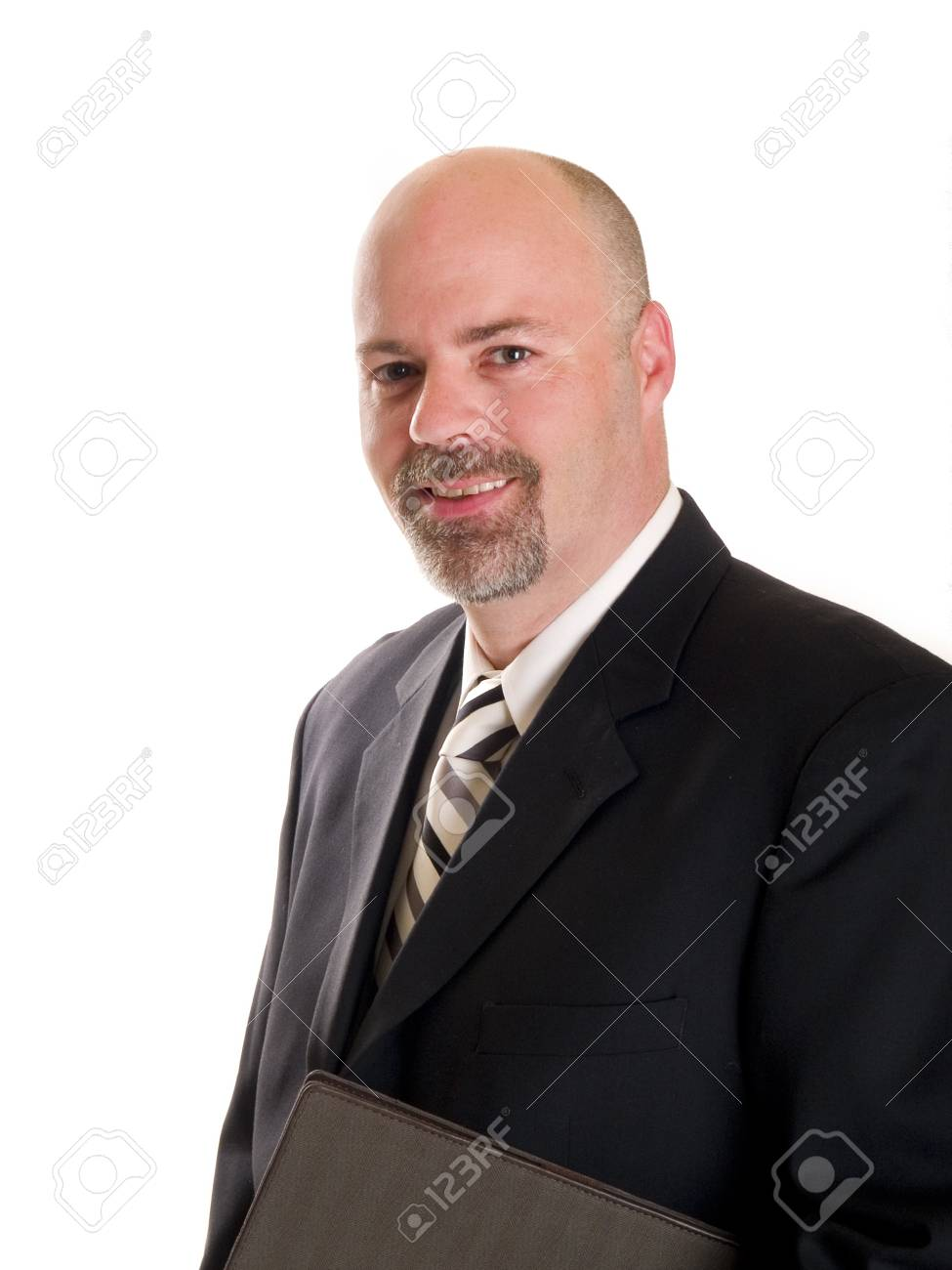 Stock photo of a well dressed businessman holding a notebook, isolated on white. Stock Photo - 8081119
