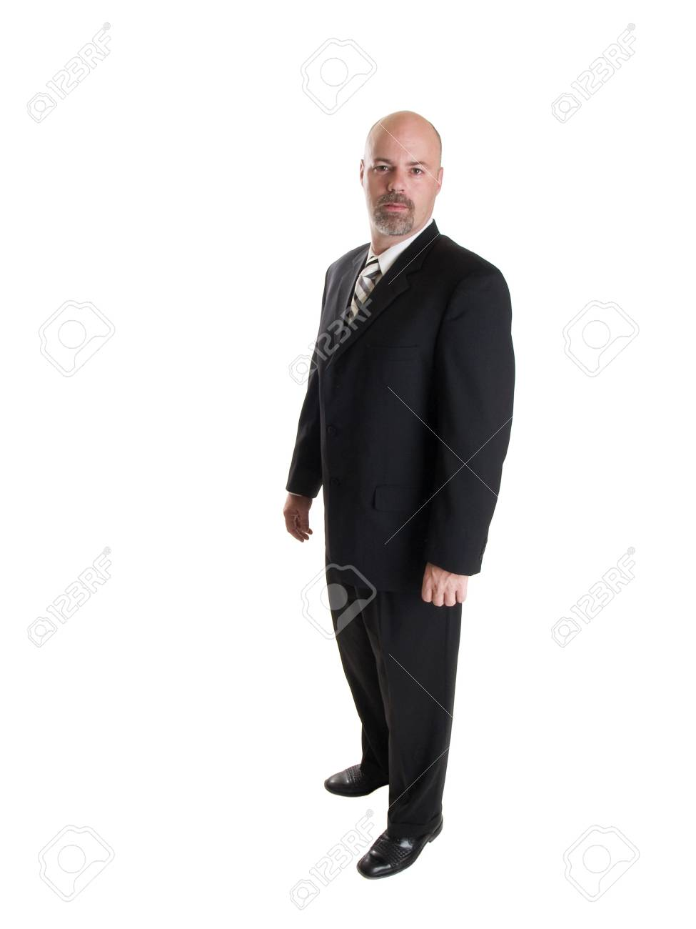 Stock photo of a well dressed confident businessman looking directly at the camera, isolated on white. Stock Photo - 8080460