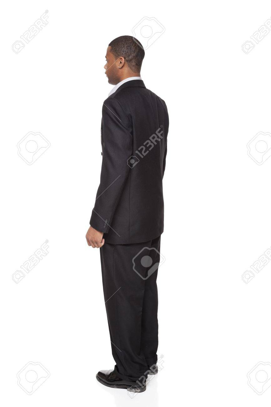 Isolated full length studio shot of the rear view of an African American businessman. - 8081580