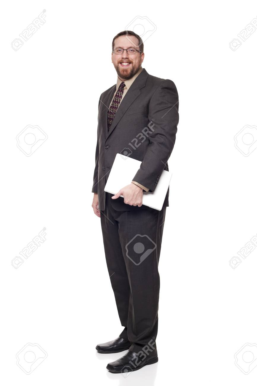 Isolated full length studio shot of the side view of a businessman carrying a laptop and looking at the camera. Stock Photo - 8081559