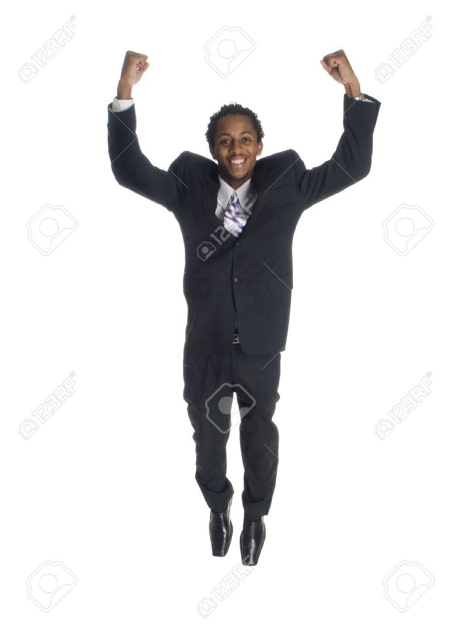 isolated studio shot of a businessman jumping for joy with clenched