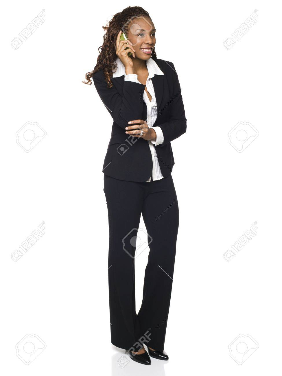 Isolated studio shot of a businesswoman talking on her cellphone. Stock Photo - 8081034