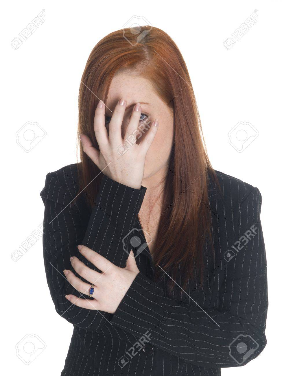 Isolated studio shot of a businesswoman who is peeking even though she just can't look. Stock Photo - 8052676