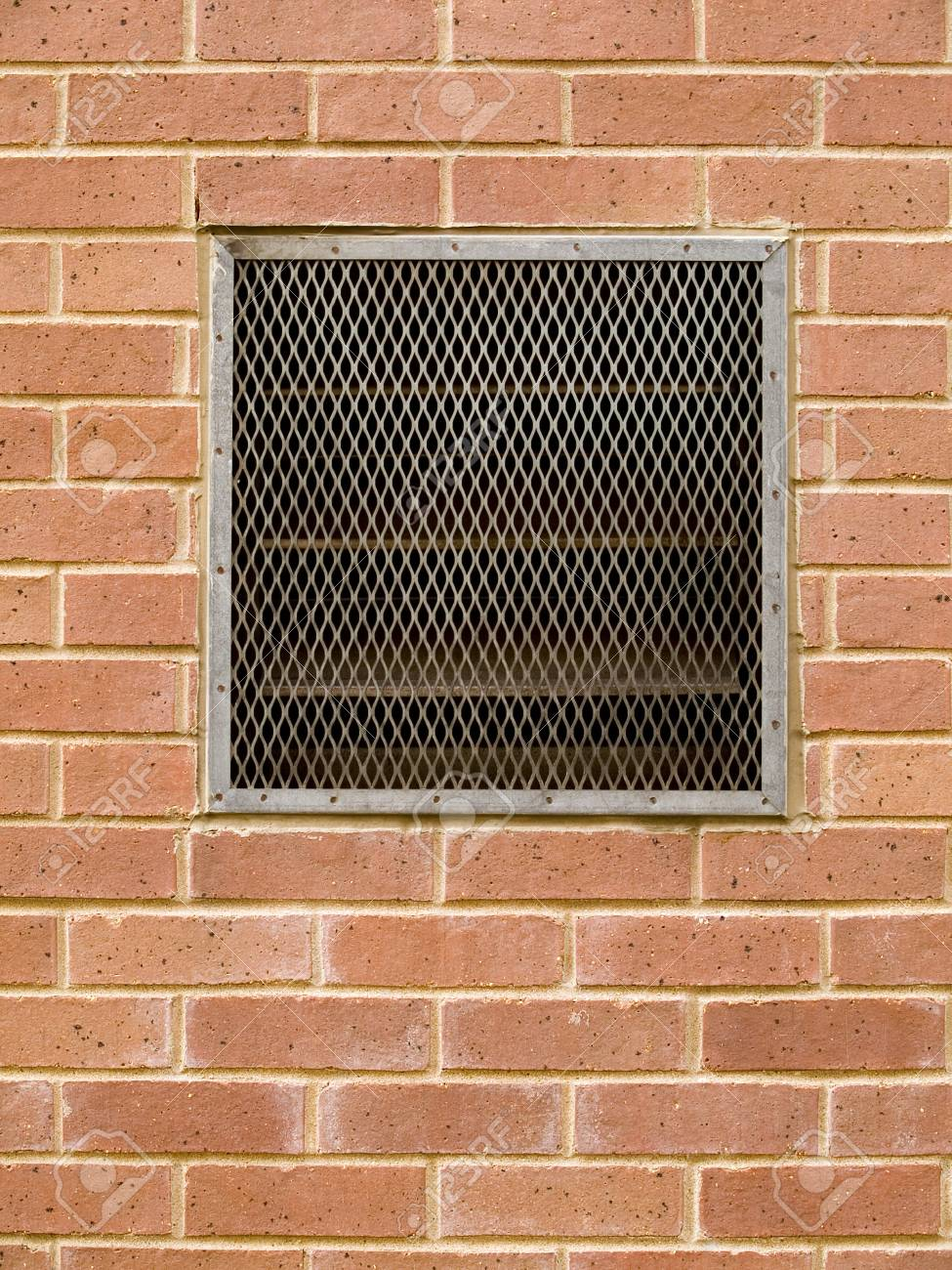 Stock Macro Photo Of A Grate Over An Air Vent Set Into A Brick