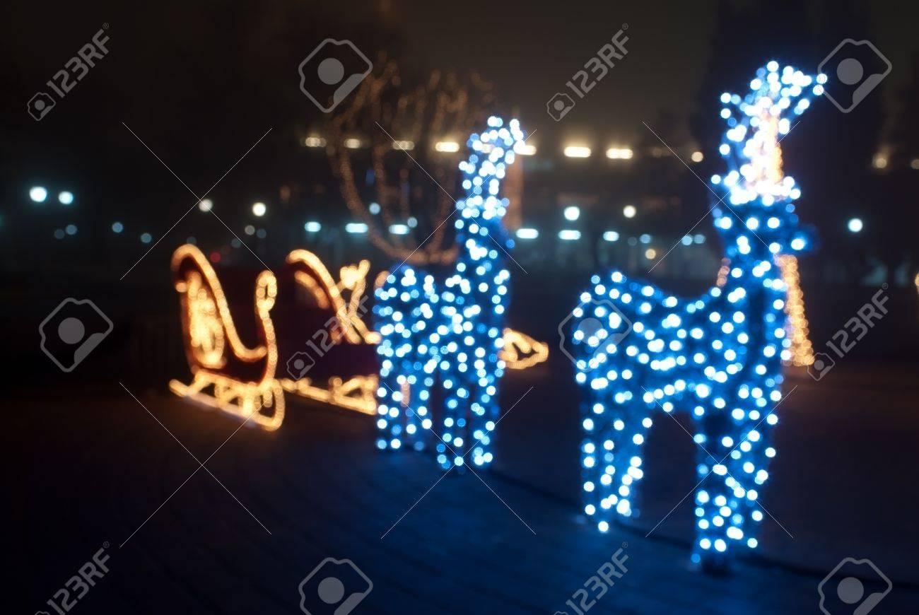 Christmas Sled Deers And Trees Bokeh Light