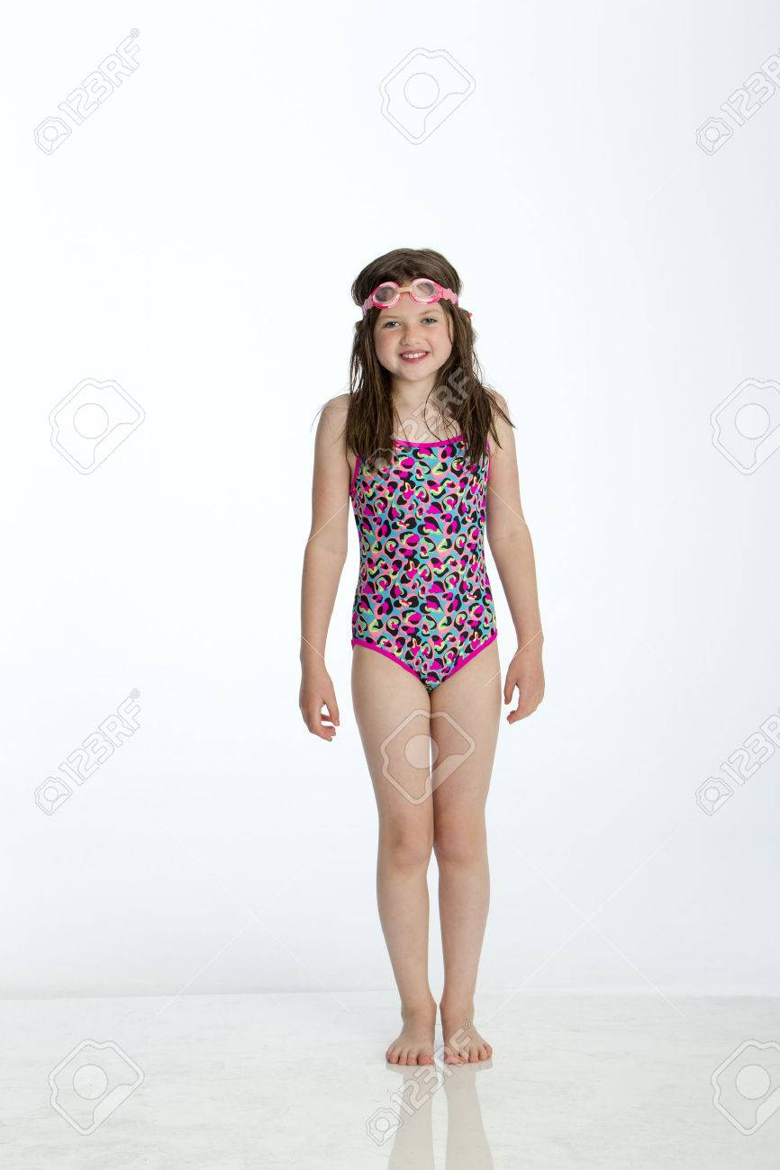 Full Length Shot Of A Little Girl Wearing A Swimming Costume Stock