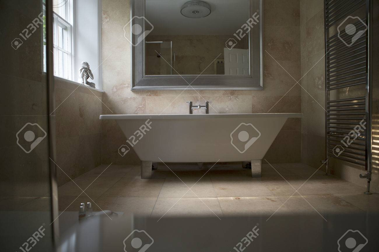 Shot Of An Elegantly Designed Bathroom. A Large Stand Alone Bath ...