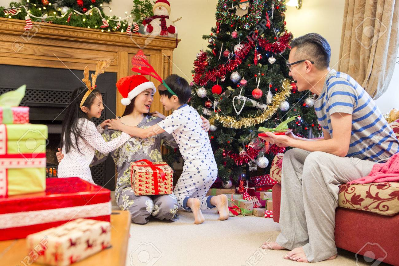 Chinese Family Enjoying Christmas In Their Home The Children