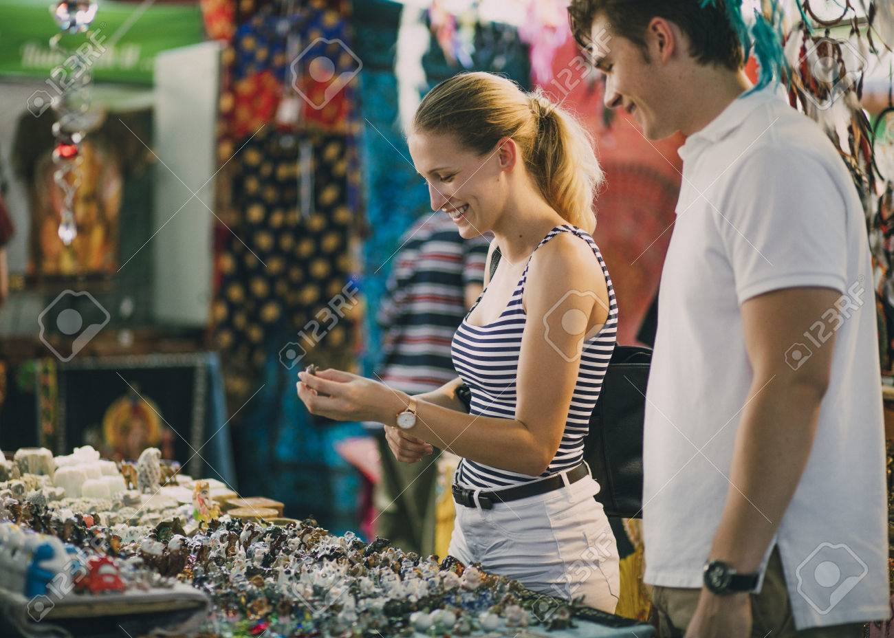 Young couple are looking at a jewellery stall in Queen Victoria Market, Australia. - 80779685