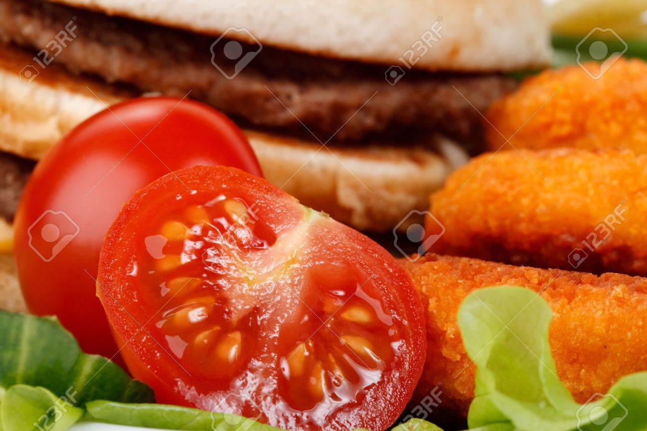Hamburger, french fries, chicken nuggets, and vegetables on a white background Stock Photo - 4152418