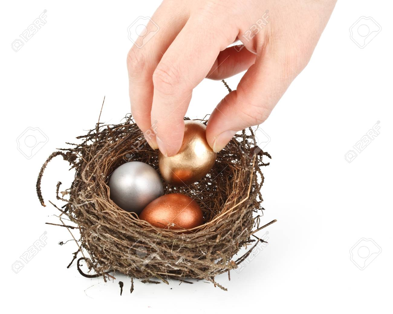 Gold, silver and bronze eggs in a real nest Stock Photo - 4345564