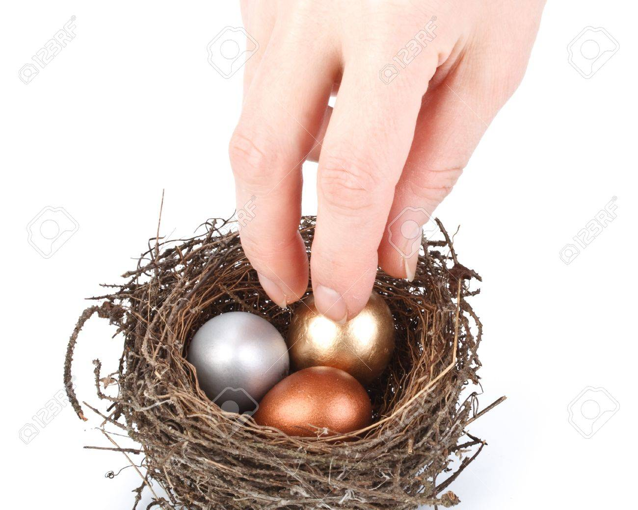 Gold, silver and bronze eggs in a real nest Stock Photo - 4388790