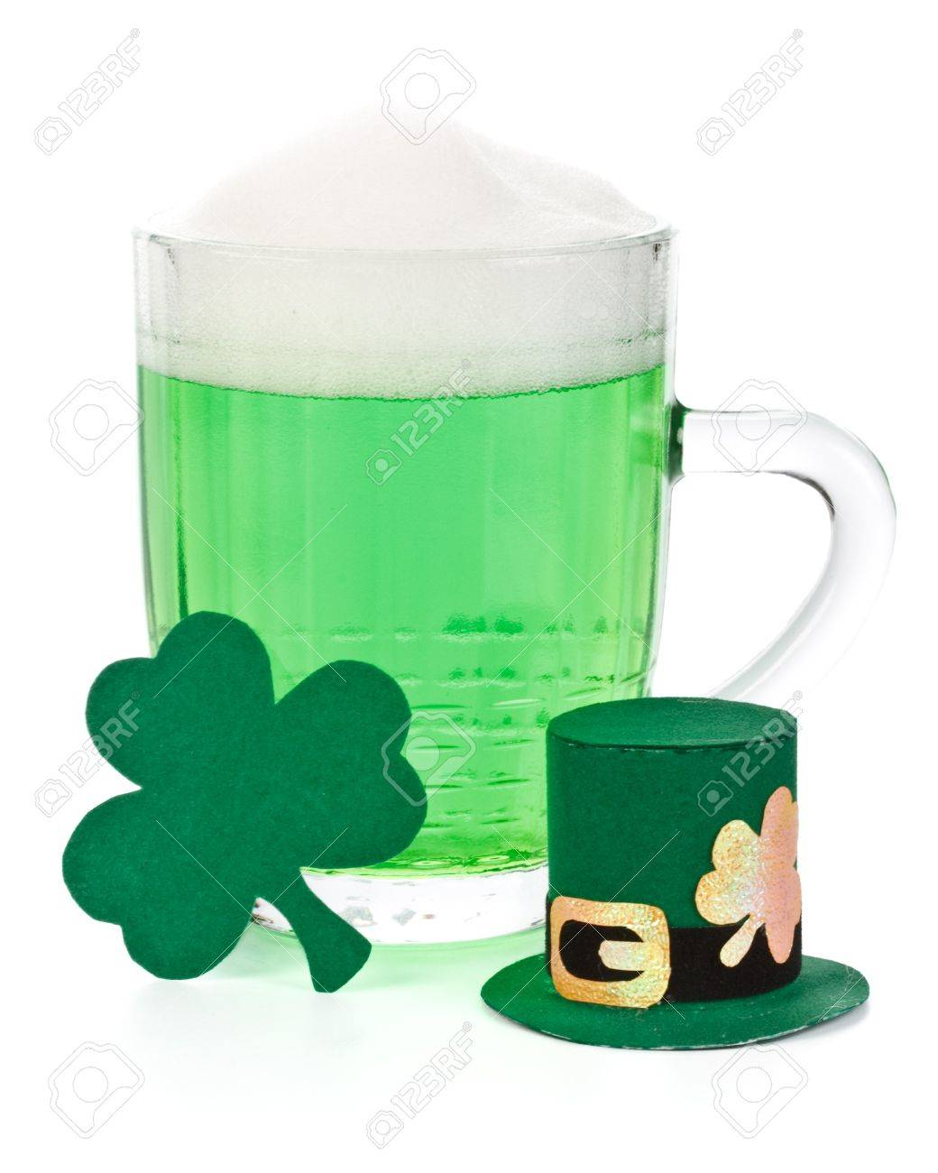 Mug of Green beer, shamrock and Leprechaun hat for St Patrick's Day Stock Photo - 4432588