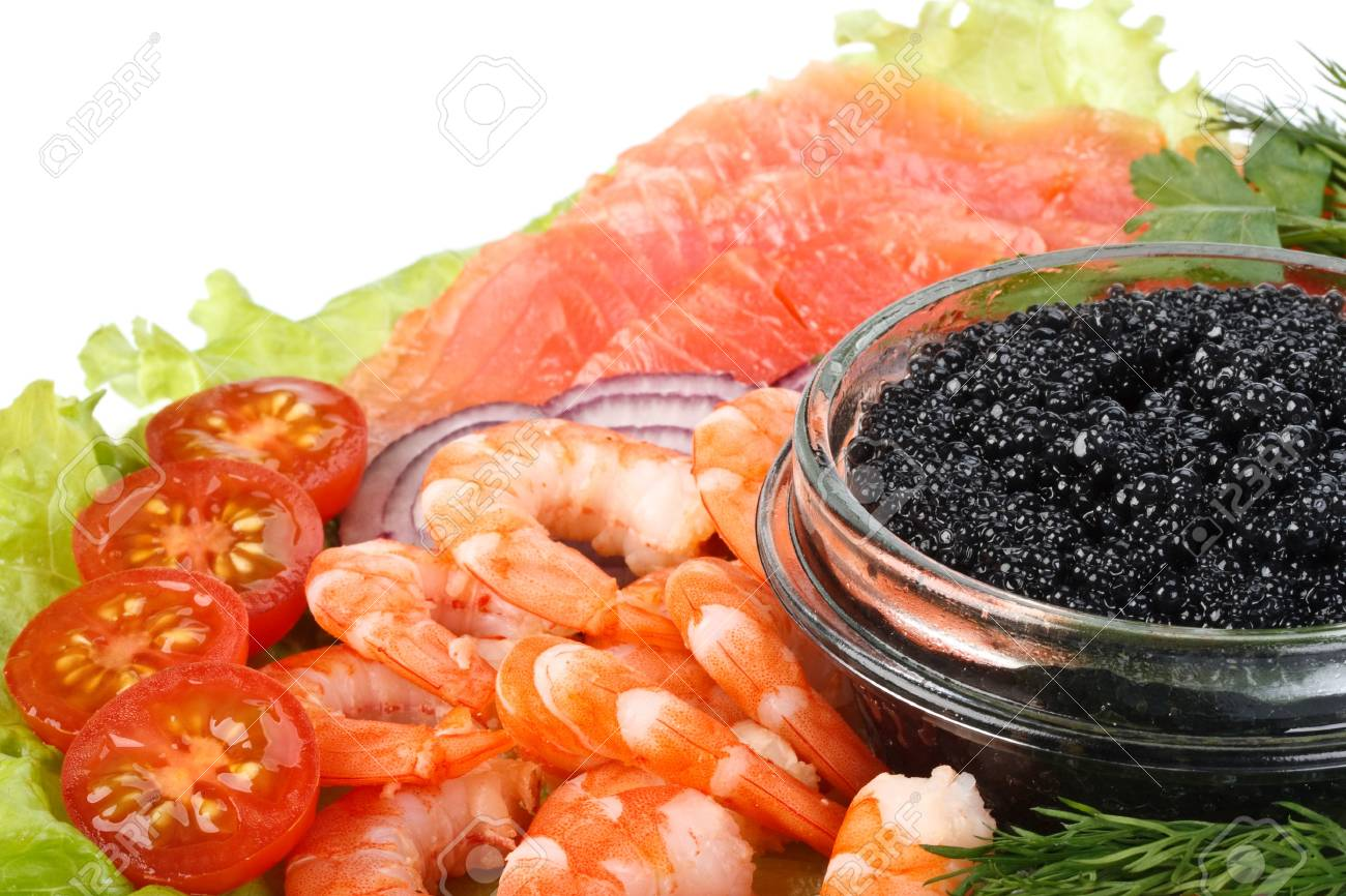 Black caviar, tiger shrimps and a salty trout with vegetables on a white background Stock Photo - 4528148