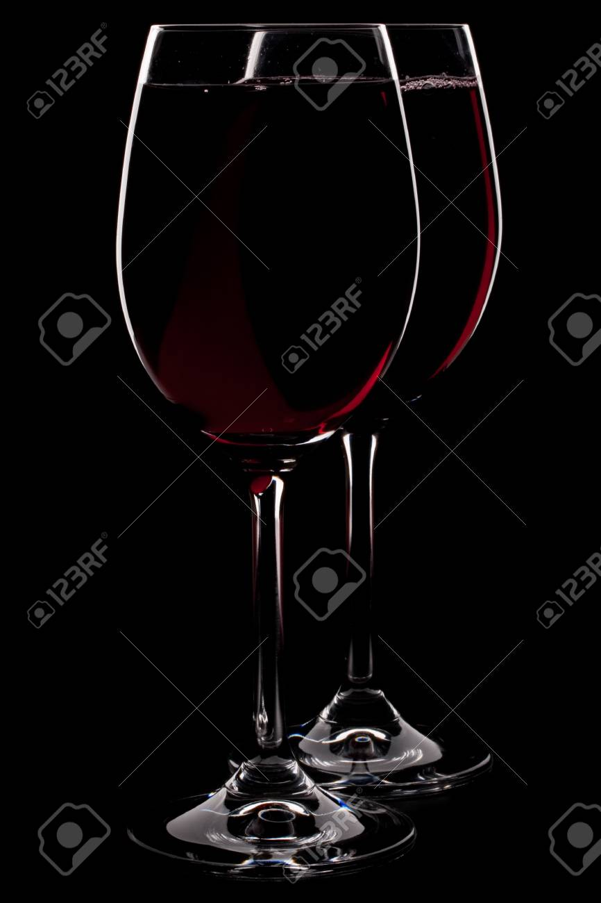 Wineglass with red wine isolated on a black background Stock Photo - 4534770