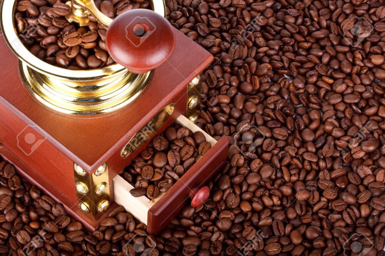 Background from old-fashioned coffee grinder and coffee beans Stock Photo - 4796671