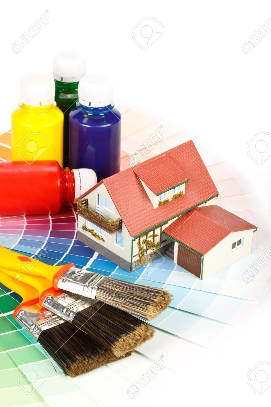 Various painting tools, miniature house and color guide on a white background Stock Photo - 4837714