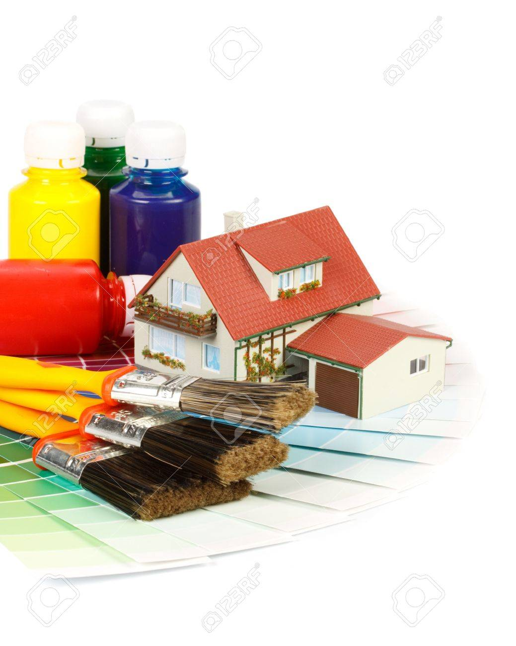 Various painting tools, miniature house and color guide on a white background Stock Photo - 5286066