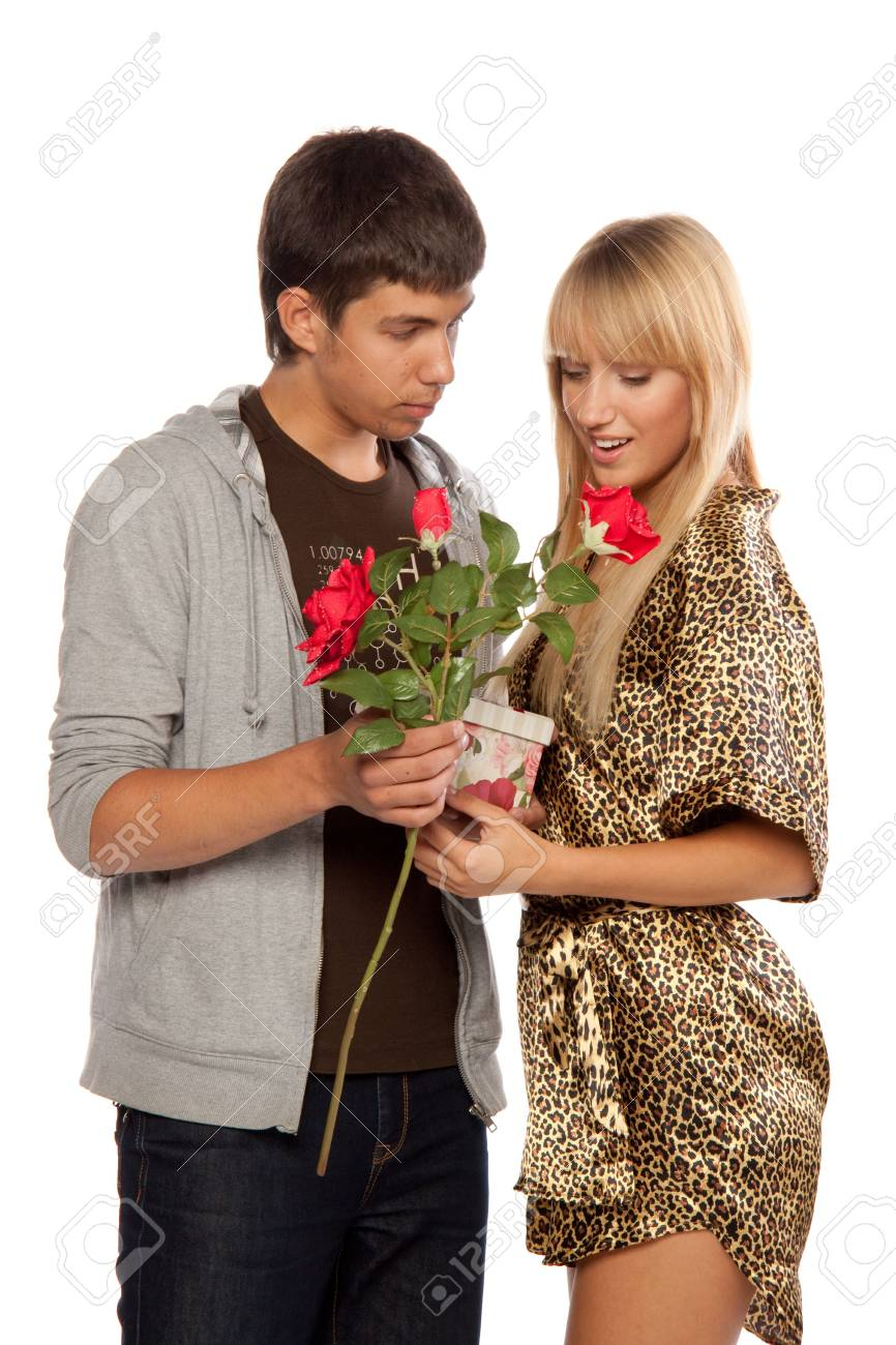 The young enamoured man gives a gift to the girlfriend on a white background. Stock Photo - 5563880