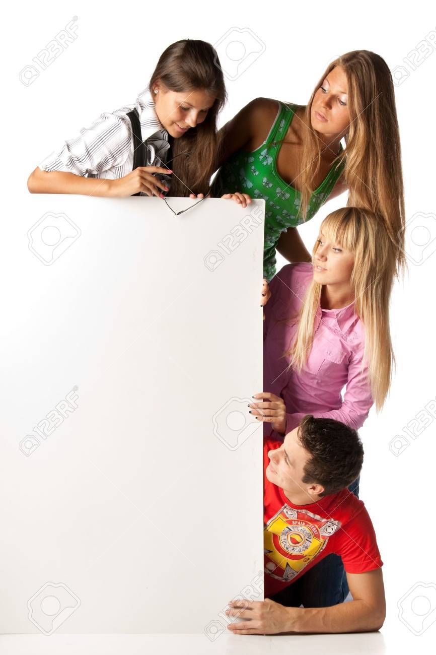 The group of young people holds the empty board for the text on a white background. Stock Photo - 5619495