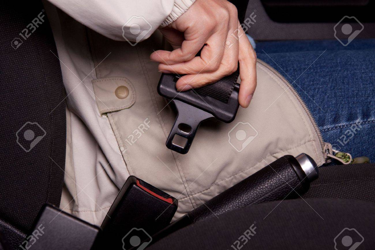 Female hand  fastening  a seat belt in the car. Stock Photo - 6316691