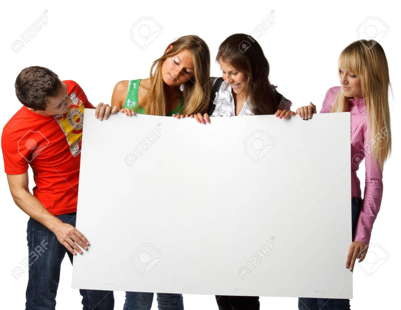 The group of young people holds the empty board for the text on a white background. Stock Photo - 6427862