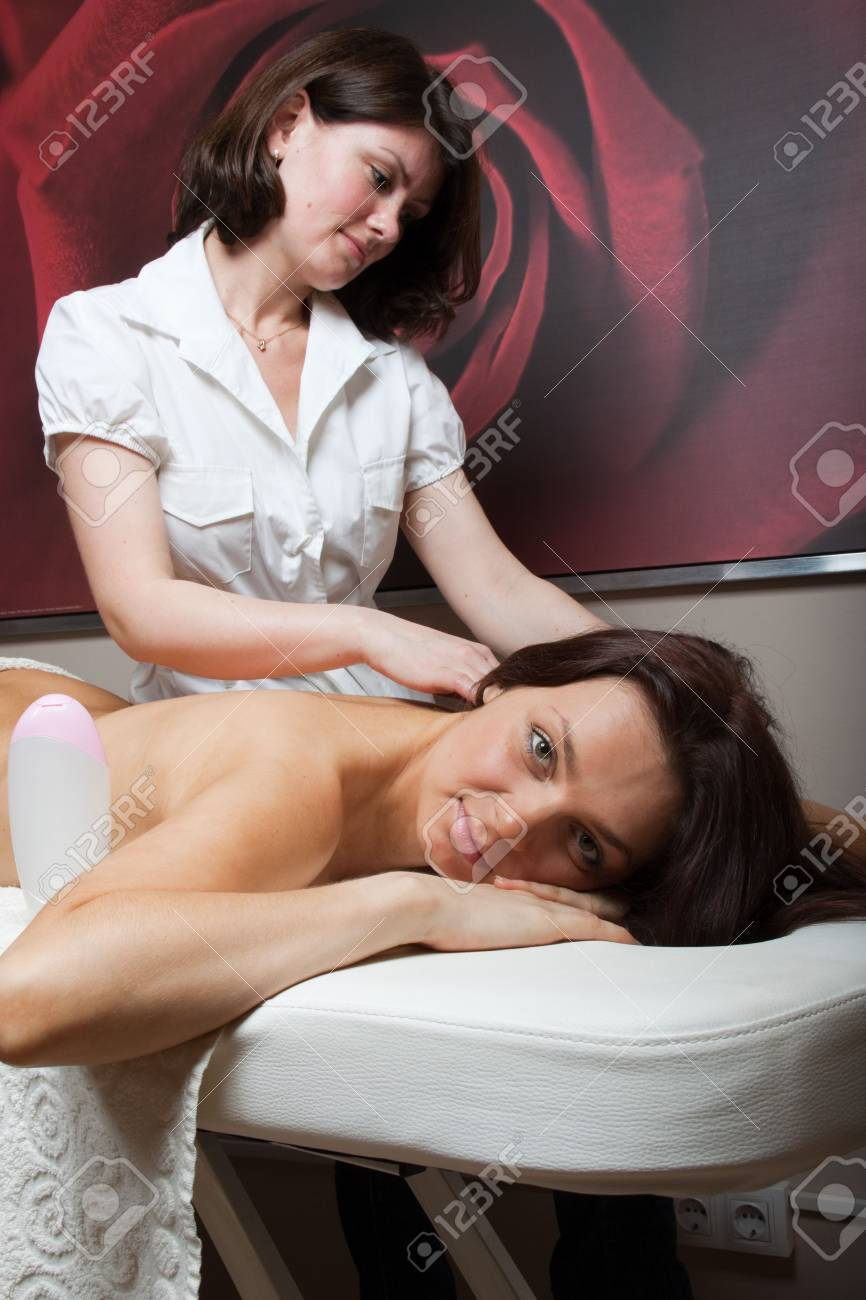 The nice female masseur carries out massage procedure in spa salon. Stock Photo - 6715920