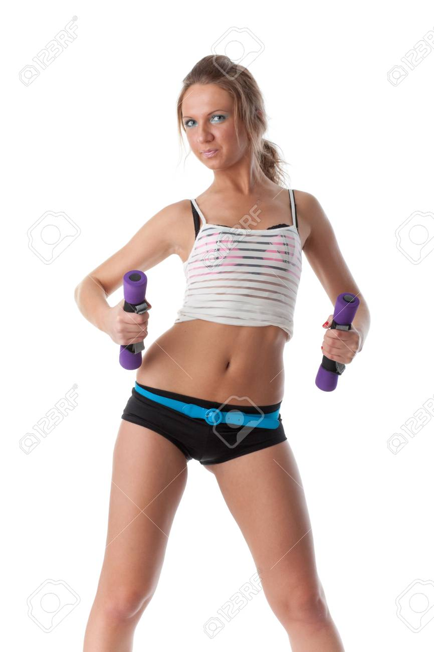 The beautiful sports girl with dumbbells on a white background. Training. Stock Photo - 6814128