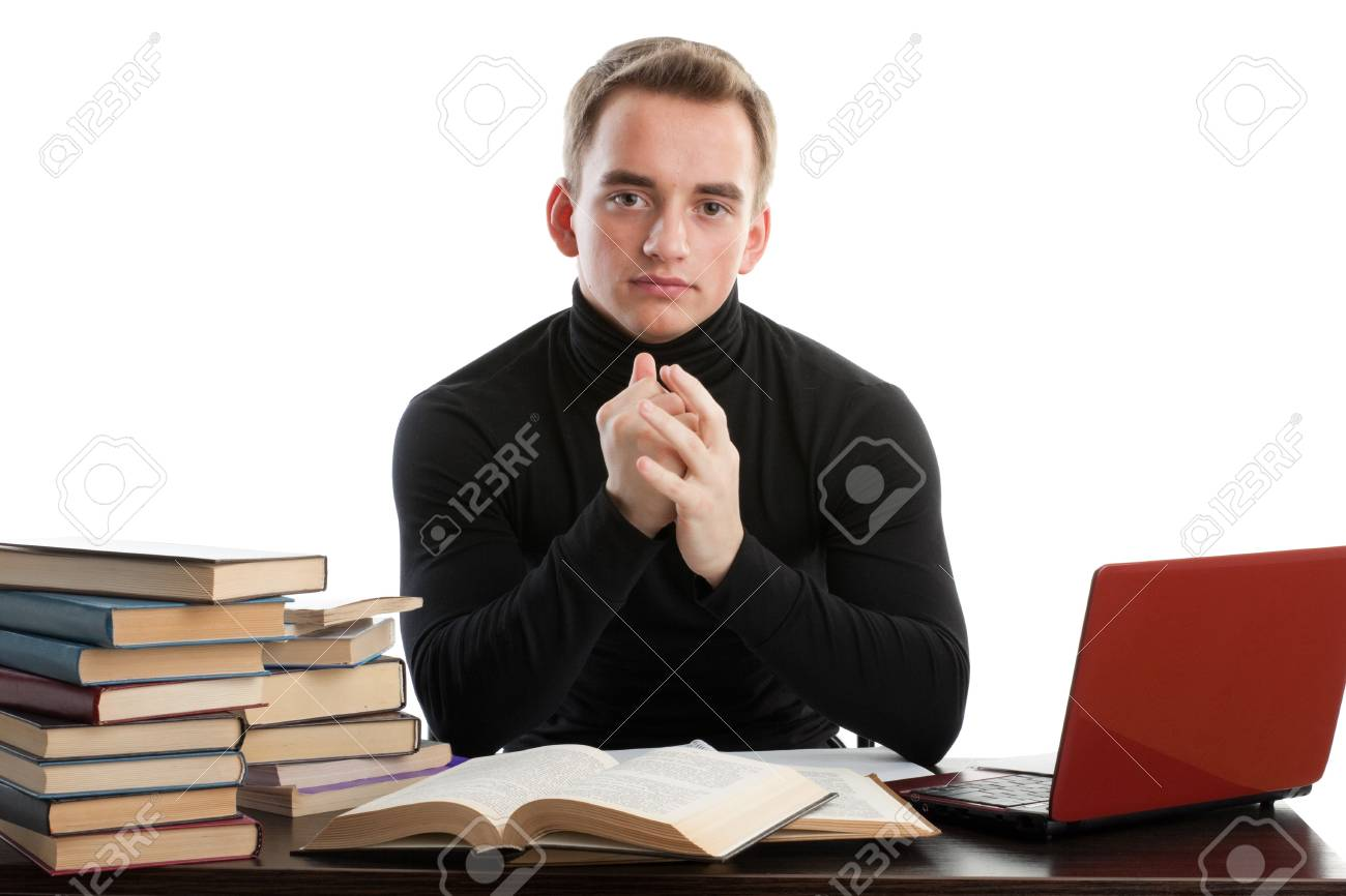 Stressed young man sitting at a table among books and  laptop on a white background Stock Photo - 7002071