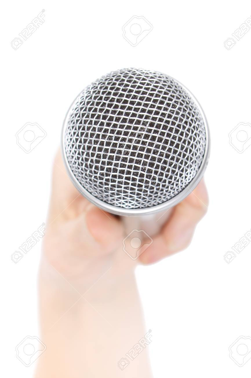 Silver microphone in a female hand on a white background. Stock Photo - 7068540