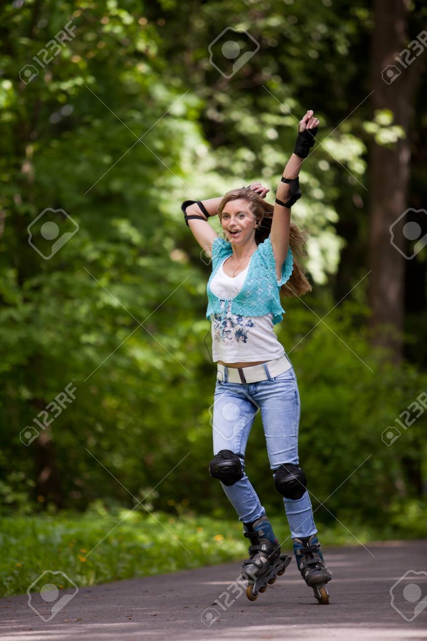 The beautiful young woman rollerskating in park. Stock Photo - 7217112