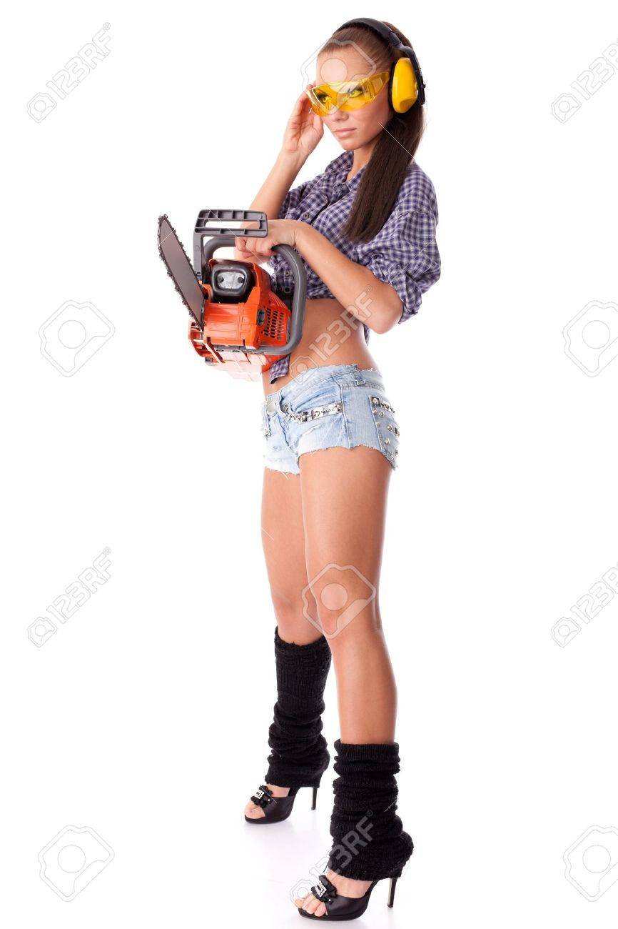 The young woman with a chainsaw on a white background. Stock Photo - 9436364
