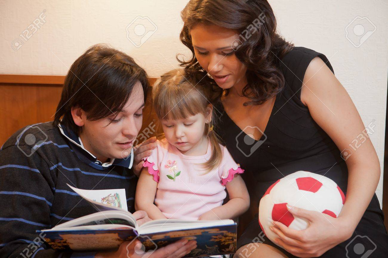 Young parents with their  daughter at home. Happy family. Stock Photo - 9529322