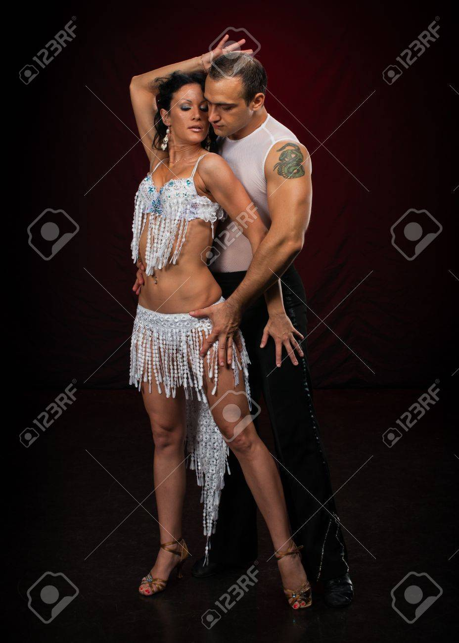 Dancing young couple on a dark background. Stock Photo - 11816572