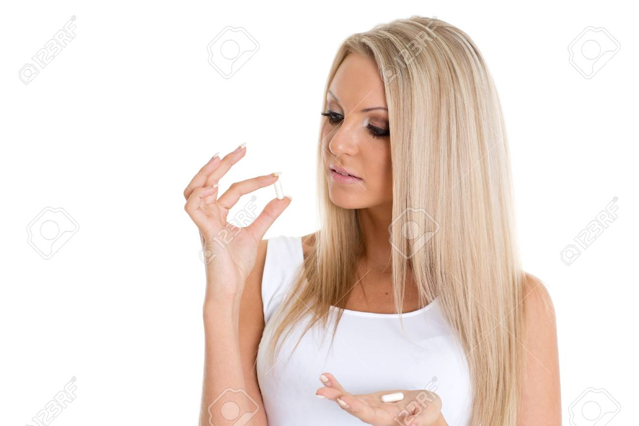 Young slender woman with pills on a white background Stock Photo - 20151519